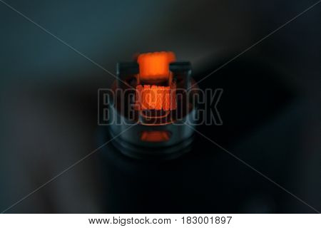 Glowing Spiral Of The Electronic Cigarette For Background. Personal Vaporizer. Ends.