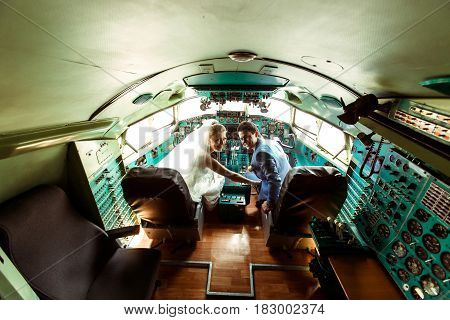 Crazy Couple Inside The Cabin Of An Old Plane