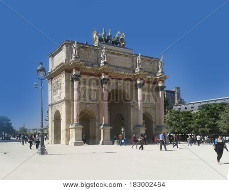 Paris, famous Triumphal Arch located at the end of Champs-Elysees street. UNESCO World Heritage Site. Bright sunny day. PARIS, FRANCE APRIL 17, 2014