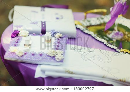 Wedding rings and the purple wedding decorations