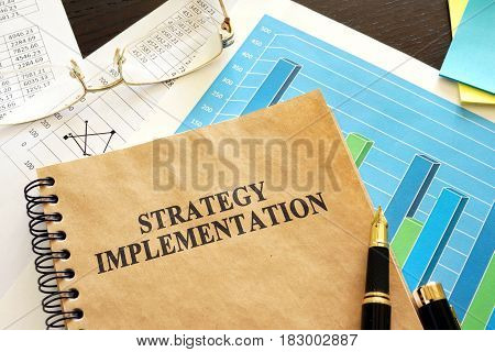 Book with title strategy implementation and financial data.