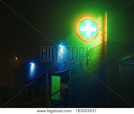 Street with fog and green cross, at