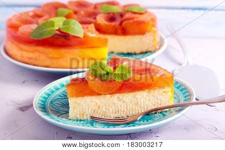 Apricot jelly topping cheesecake served on plate