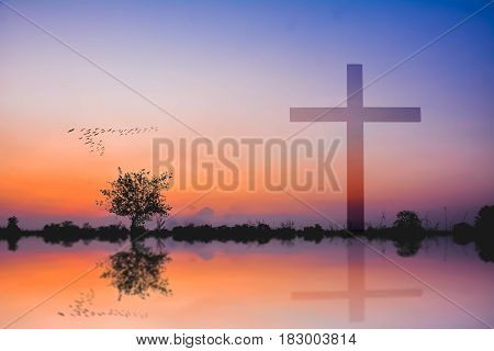 Cross Against Mountain And Lake View At Sunset