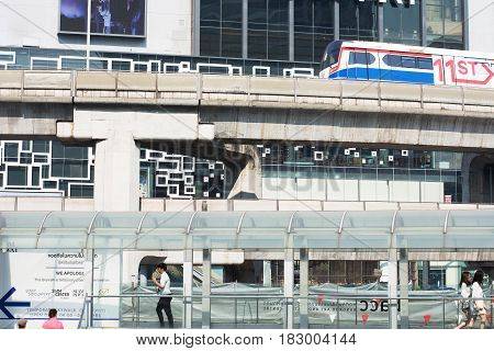 Bangkok-Thailand 1 March 2017: BTS Sky train mass transit system moving to arrive in platform of central business area of Bangkok.
