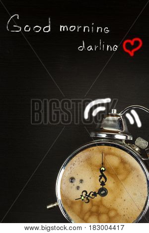 Retro alarm clock with coffee. Morning coffee after waking up. Wake up. Place for ad text.