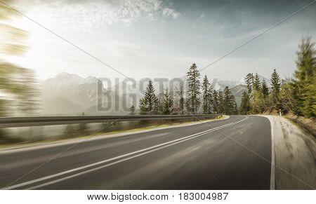 Torutous mountain road in winter at dawn