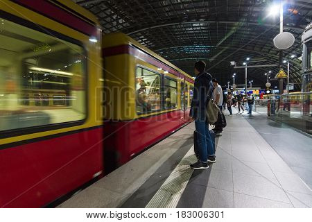 BERLIN - JUNE 20 2016: Berlin Central Station in the night. Arrival of urban electric trains (S-Bahn). The central station of Berlin - the largest and modern railway station of Europe.