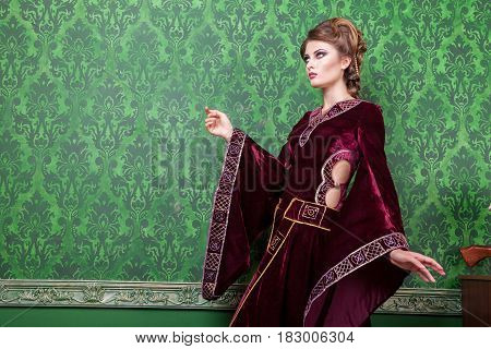 Gorgeous person dressed in vintage clothes in retro interior. Rococo period. Luxury and high class