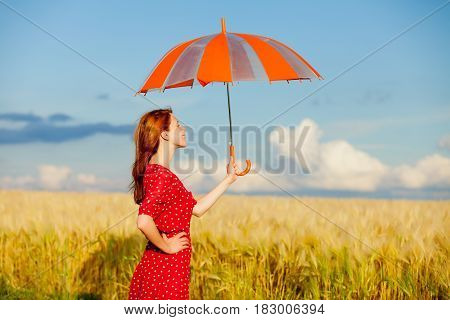 Photo Of Beautiful Young Woman With Umbrella On The Wonderful Field Background
