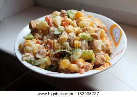 light salad from young corn under sauce in bowl
