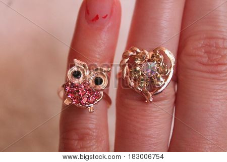 golden jewelry rings put on fingers for beautify