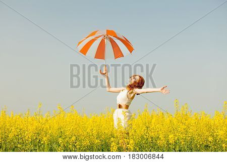 Photo Of Beautiful Young Woman With Umbrella On The Wonderful Flower Field Background