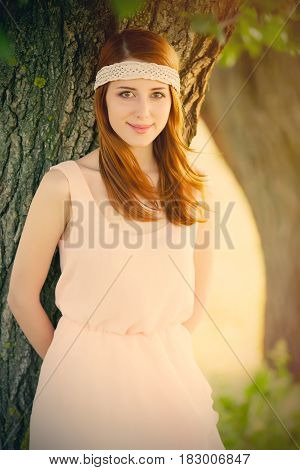 Portrait Of Beautiful Young Woman Near Tree On The Wonderful Park Background