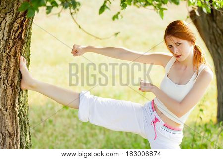 Photo Of Beautiful Young Woman Doing Joga On The Wonderful Trees Background