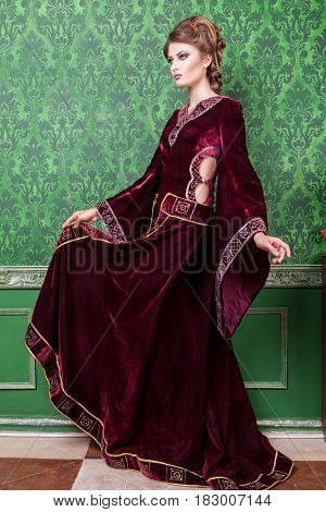 Luxurious woman dressed in vintage clothes in retro interior. Rococo period. Luxury and high class