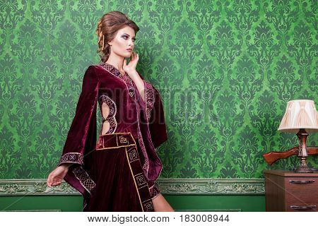 Sensual woman dressed in vintage clothes in retro interior. Rococo period. Luxury and high class