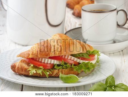 Breakfast. Sandwich Croissant With Cheese, Tomatoes And Basil. Caprese. Selective Focus