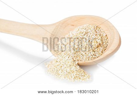 bran in wooden spoon isolated on white background. Food supplement to improve digestion. Dietary fiber. Product for healthy nutrition and diet
