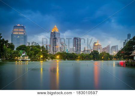 Bangkok Thailand - september 04 2016: evening scene of Bangkok skyline at Lumphini Park in Bangkok. Lumphini Park is a park in Bangkok