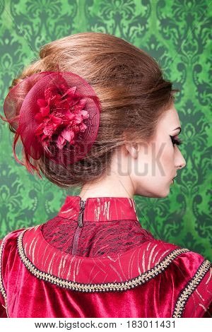 Gorgeous hairstyle in vintage interior. Rococo period. Luxury and high class