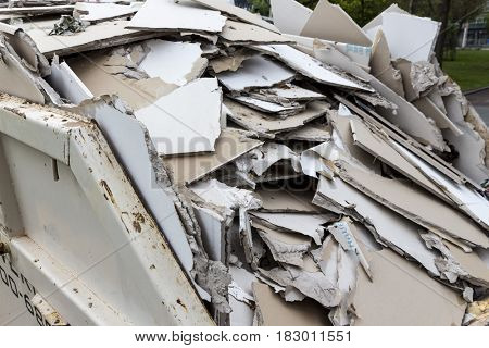 construction waste. plasterboard in container
