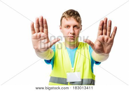 Man in vest shows hands with gesture of STOP on white background