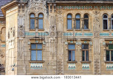 Windows on the fasade of the historic building in Lviv city, Ukraine