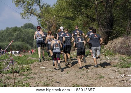 Team Running In A Physical Challenge
