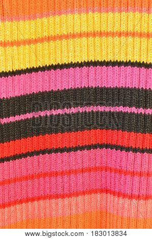 close up of colorful sweater texture and background