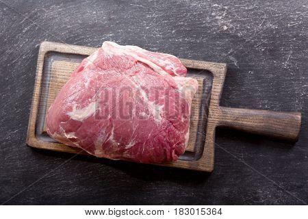 Piece Of Fresh Meat On Wooden Board