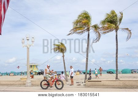 Hollywood Beach Fl USA - March 13 2017: Bicycle rider at the Hollywood Beach Broad Walk. Florida United States