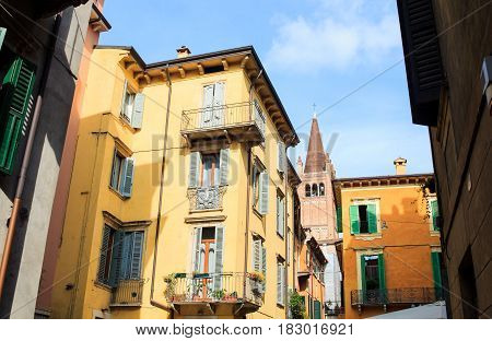 View of belltower next to the houses in Verona Italy