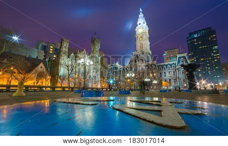 Philadelphia - April 2015, USA: Wide angle view of Philadelphia historic city center at night, one of the famous landmarks - building of Philadelphia City Hall, the seat of government for the city
