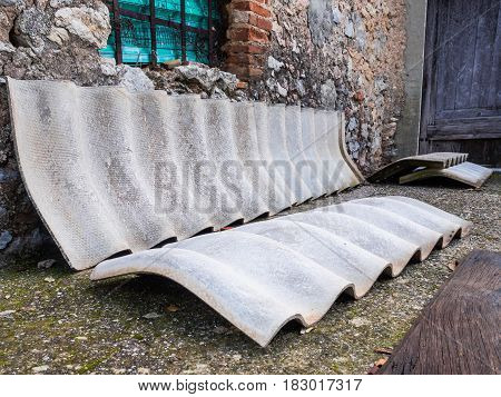 Some curved elements of concrete and asbestos covering on the ground
