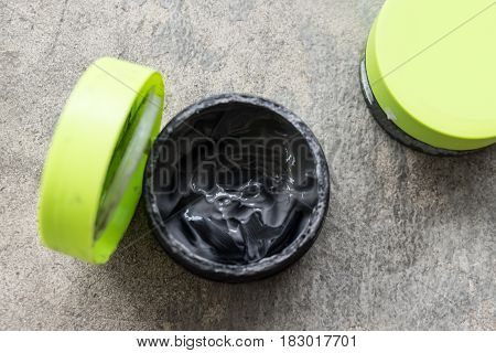 Open hair wax and clay in tubs black clay