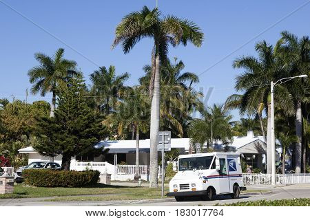 Hollywood Fl USA - March 21 2017: United States Postal Service (USPS) truck delivering in a residential neighborhood in Hollywood. Florida United States