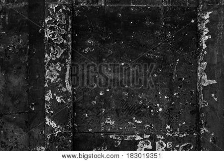 Black vintage background with shabby old peeled surface colorful old wooden door