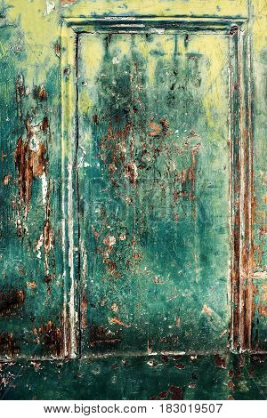 Rustic wood background with shabby old peeled surface colorful old wooden door
