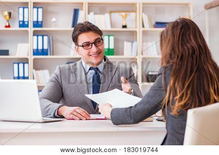Business meeting between businessman and businesswoman