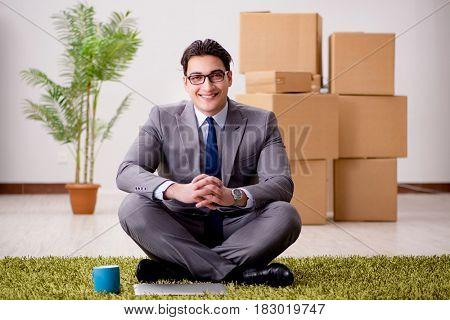 Businessman sitting on office floor