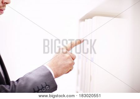 File folders, standing on shelves in background