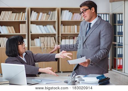 Angry boss reprimanding fellow employee