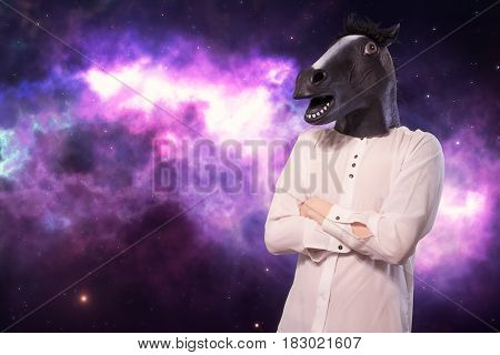 Businessman In A Horse Mask The Background Of Space