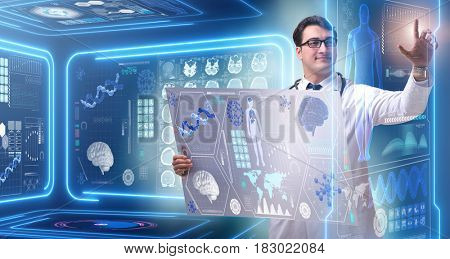 Young male doctor in futuristic medical concept