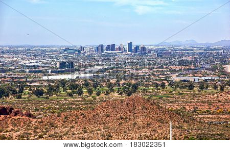 Aerial view of the downtown Phoenix Arizona skyline from above Papago Park