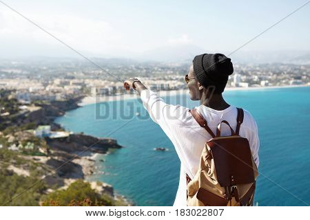 Portrait Of Unrecognizable Young African Man In Black Hipster Hat Standing On Sightseeing Platform A