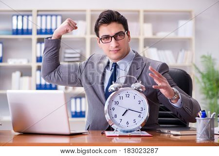 Young businessman in time management concept