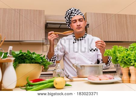 Young chef working in the kitchen
