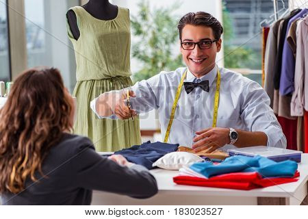 Young man tailor working with female client